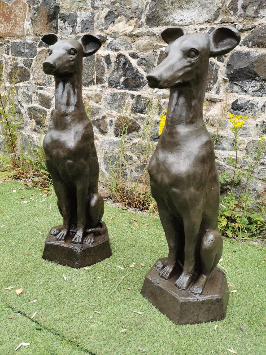 Pair of cast iron seated Whippets.