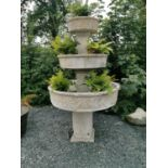 Unusual three tiered composition plant stand.