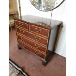 Mahogany and satinwood chest of drawers.