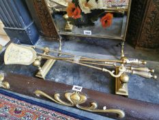 Set of Edwardian brass fire irons and fire dogs.