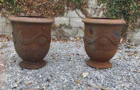 Pair of cast urns.