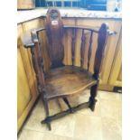 Arts and Crafts oak corner armchair