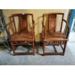Pair of fruit wood Chinese open arm chairs.