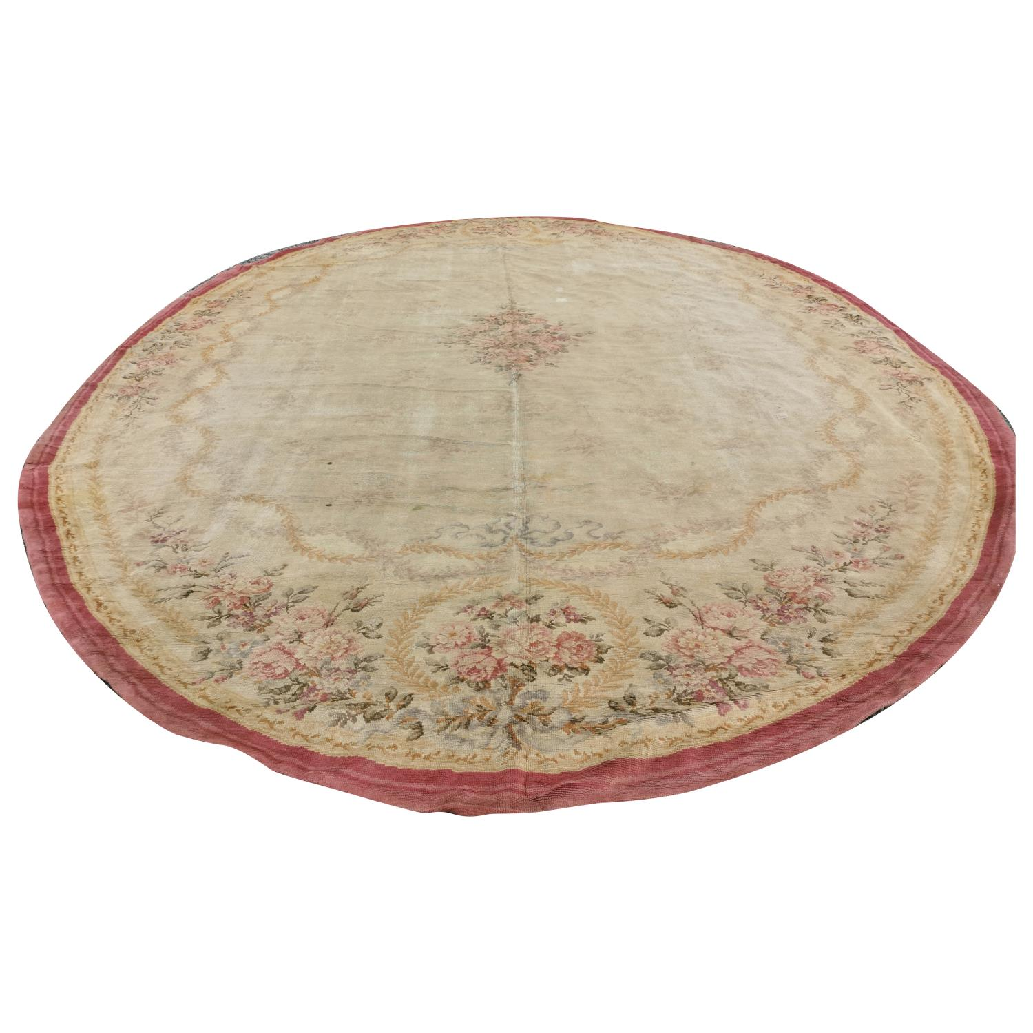 Large early 20th C. hand woven oval carpet.