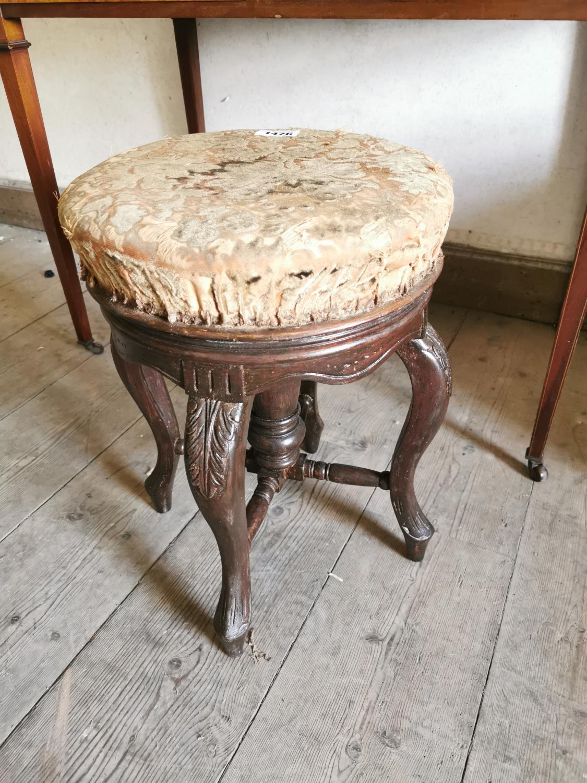 Edwardian carved mahogany piano stool.