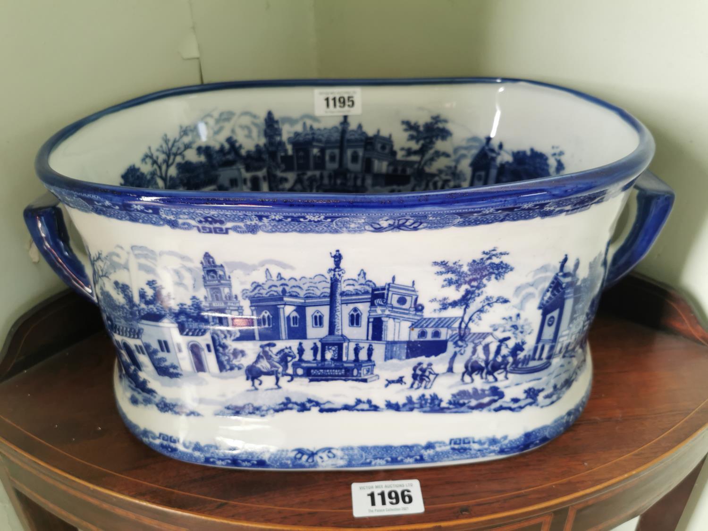 Decorative blue and white ceramic foot bath.