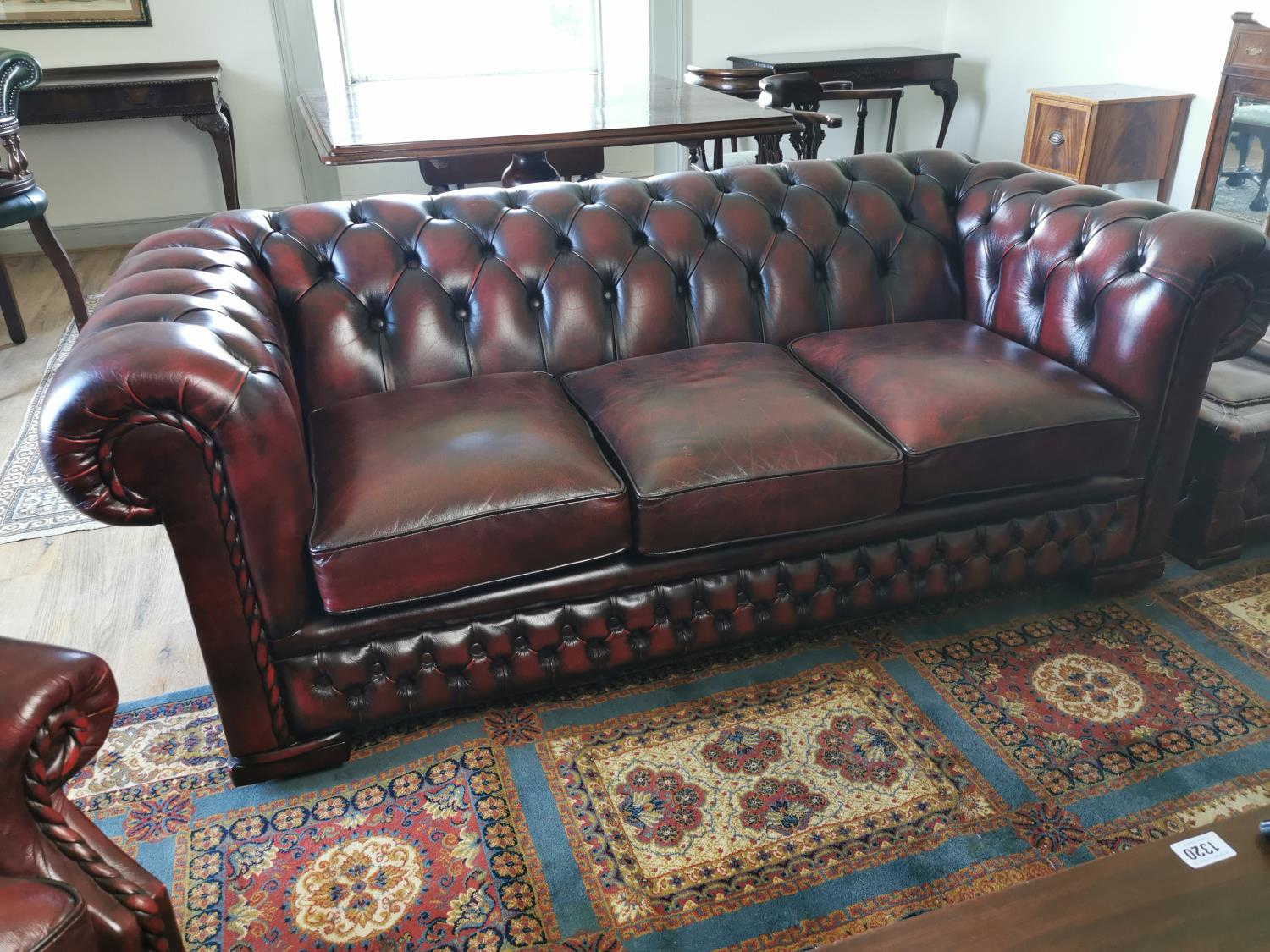 Ox blood leather Chesterfield sofa.