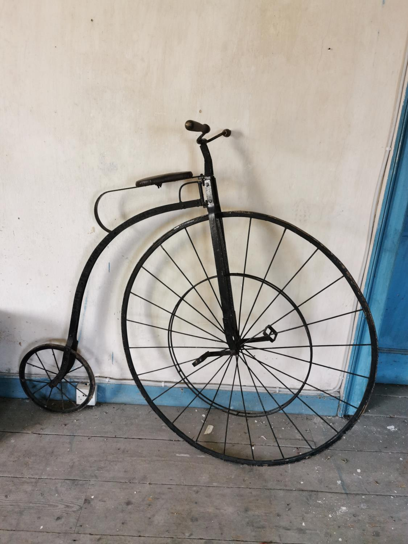 Penny Farthing with metal spoke wheels.