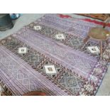 Decorative hand knotted carpet square.
