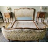 Carved walnut and upholstered French bed.