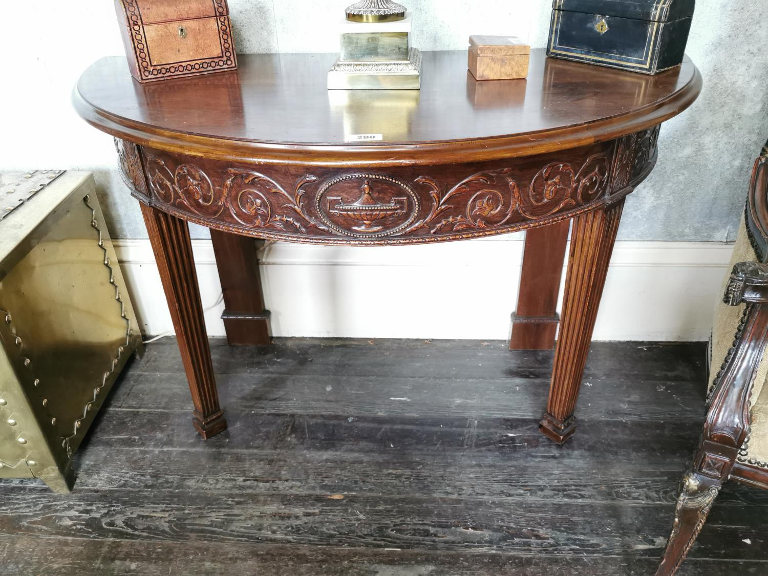Pair of mahogany demi -lune side tables