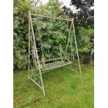 Wrought iron swing bench.
