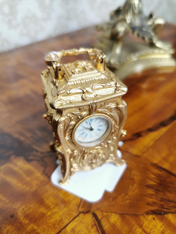 Miniature gilded brass clock
