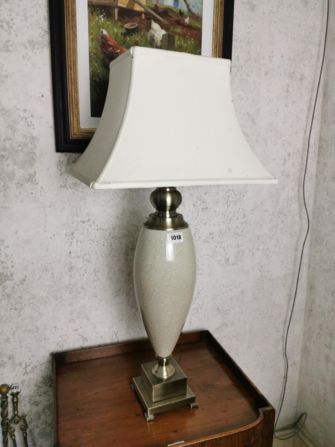 Brushed steel and ceramic table lamp.
