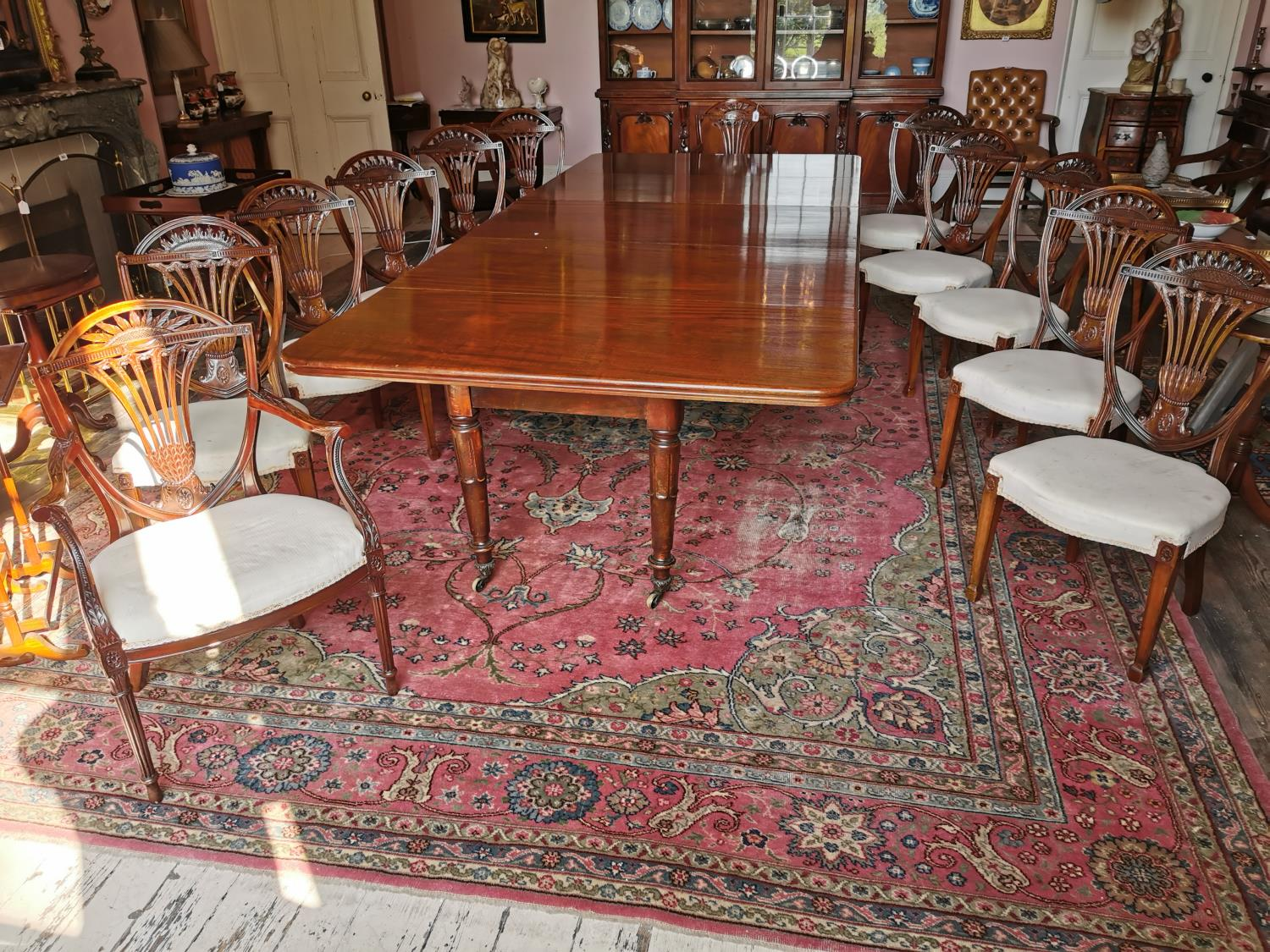 Set of ten plus two Edwardian mahogany dining chairs.