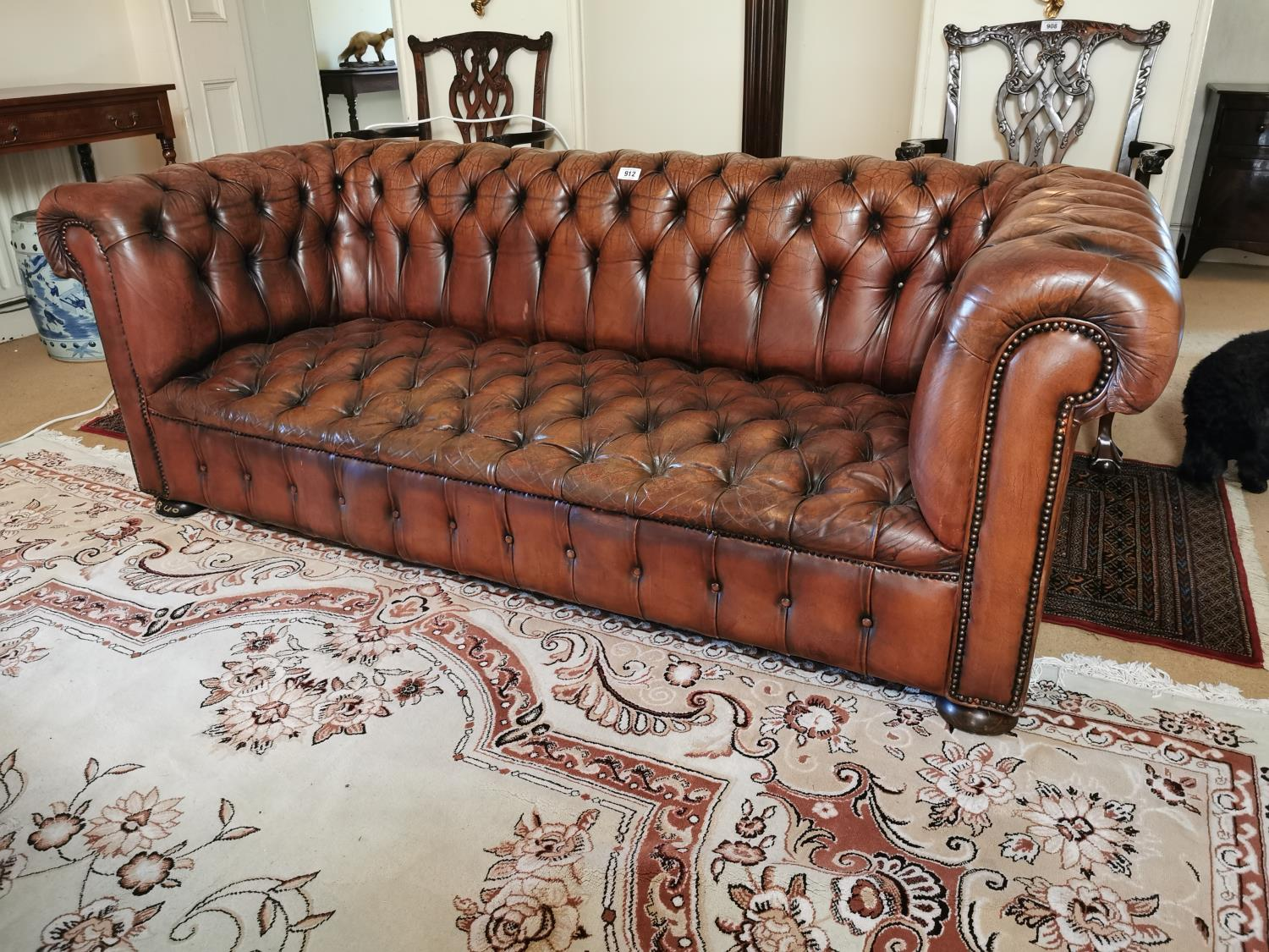 Hand dyed leather Chesterfield sofa.