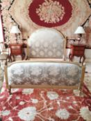 19th C. giltwood and silk upholstered French bed.