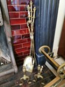 Edwardian set of brass fire irons and fire dogs.