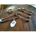 Four English silver sugar tongs