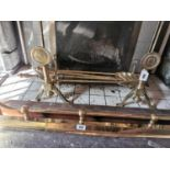 Set of 19th. C. brass fire irons and fire dogs.