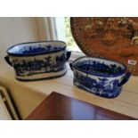 Two blue and white ceramic foot baths.