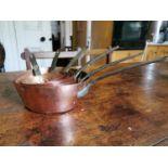 Set of six copper saucepans