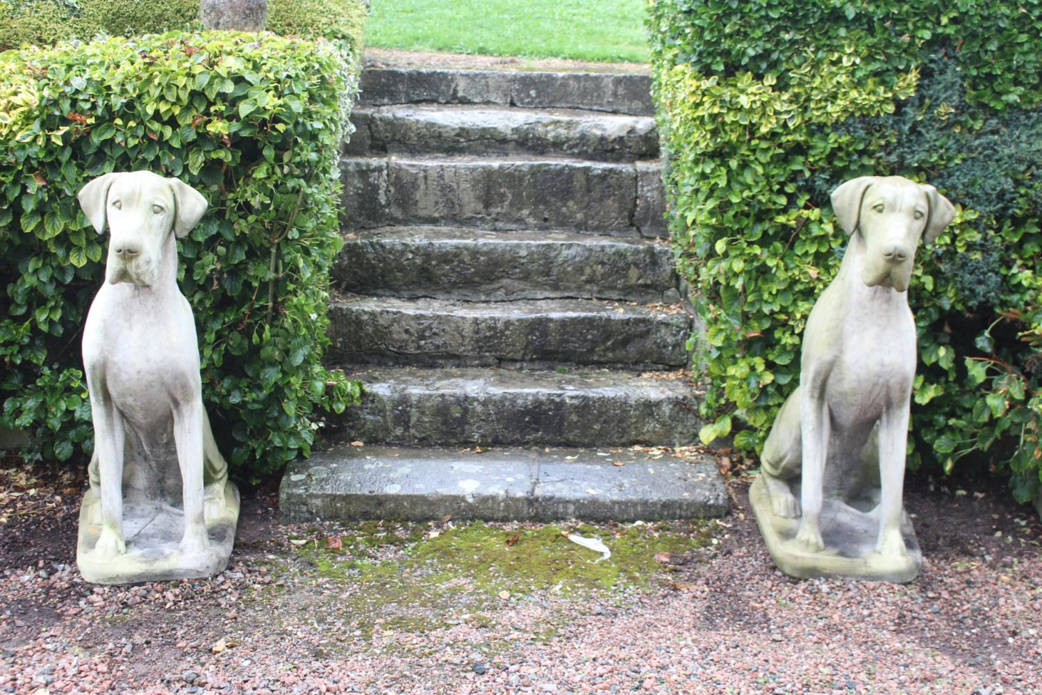 Pair of good moulded stone models of dogs.