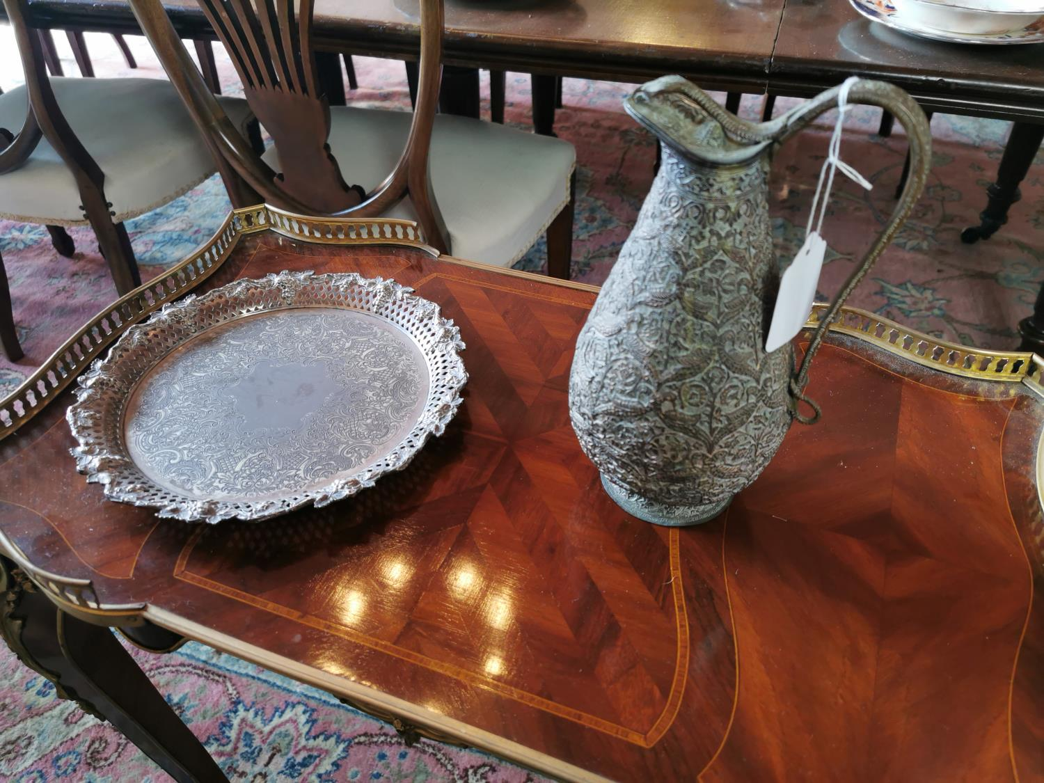 Copper water jug and silverplate tray.
