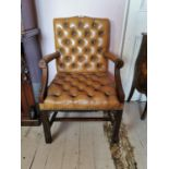 Mahogany and leather open arm chair.