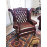Ox blood leather Chesterfield arm chair.