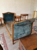 Edwardian carved walnut and upholstered single bed.
