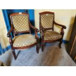 Pair of 19th C. carved mahogany arm chairs.