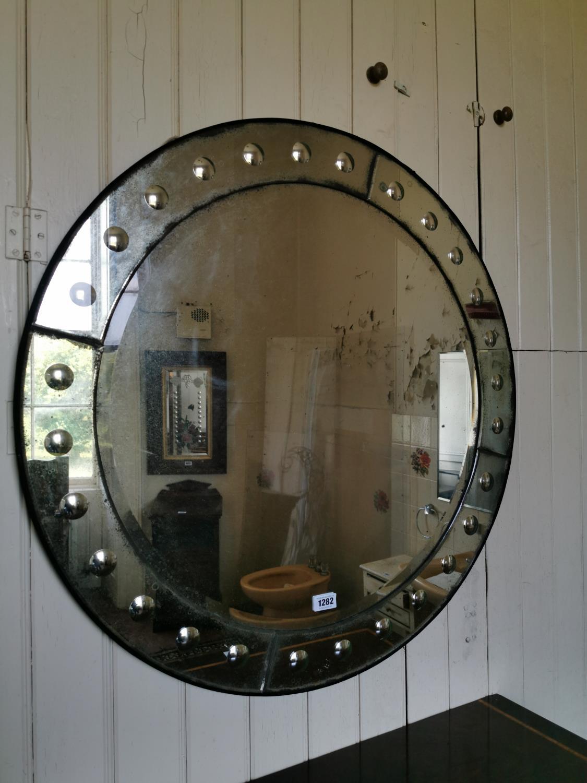 Vintage distressed wall mirror.