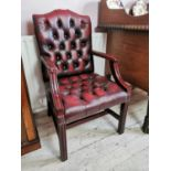 Pair of mahogany and ox blood leather Chesterfiled chairs.