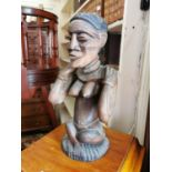 Carved wooden figurine of an African lady