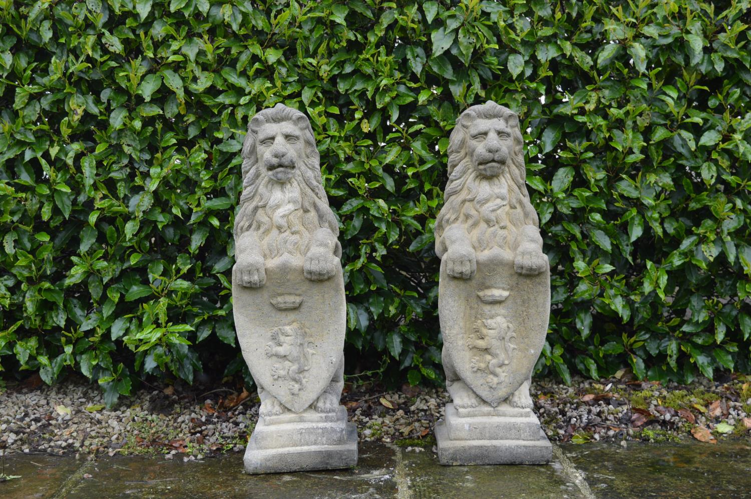 Pair of stone models of Lions.