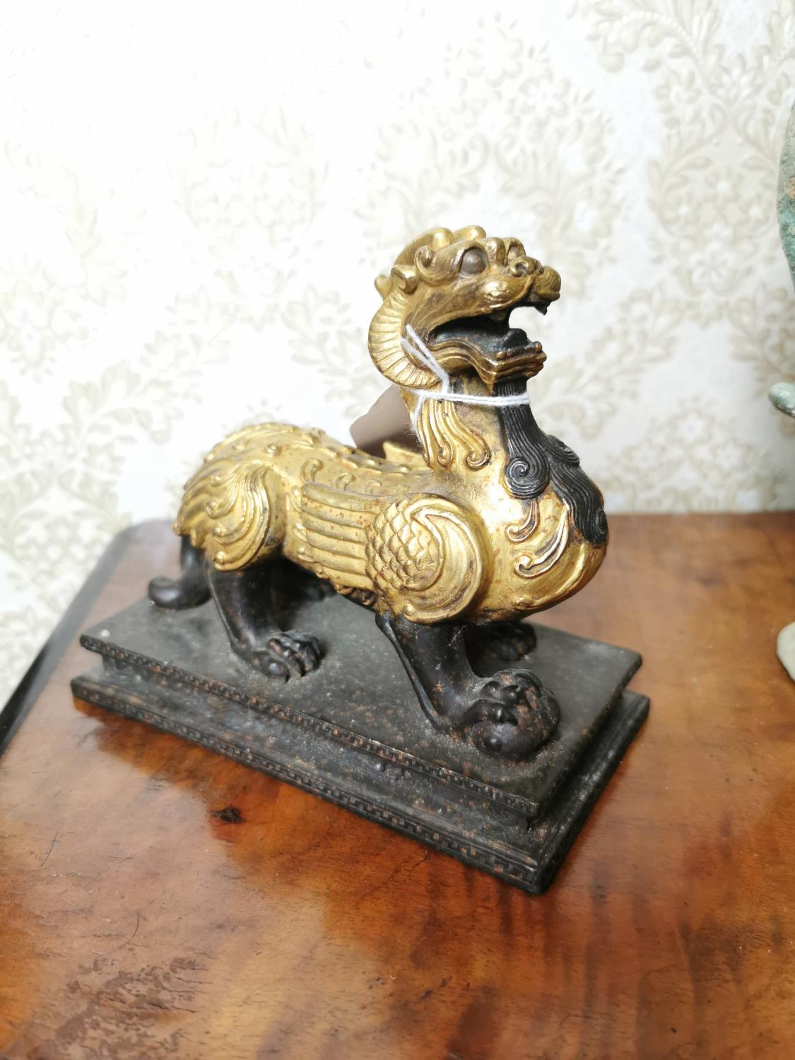 Gilded metal model of a dragon