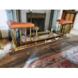 Brass extendable club fender with leather seats.