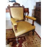 Pair of Edwardian upholstered mahogany open armchairs