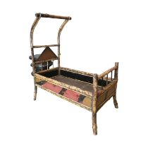 Unusual early 20th C. bamboo doll's cot
