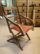 Early 20th. C. oak upholstered folding open armchair.