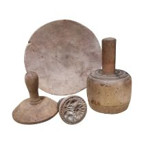 19th C. Pine skimmer plate and three 19th C. butter stamps