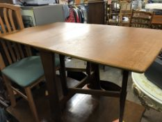 NARROW TEAK DROP FLAP TABLE AND FOUR GREEN UPHOLSTERED DINING CHAIRS