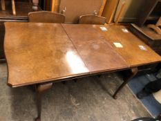 WALNUT CABRIOLE LEG EXTENDING DINING TABLE AND FOUR OAK UPHOLSTERED CHAIRS