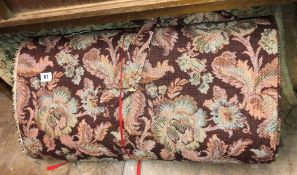 BOLT OF FLORAL FABRIC AND A RUG