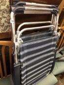 TWO STRIPED MESH AND METAL FRAMED FOLDING GARDEN/BEACH CHAIRS