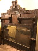 VICTORIAN JACOBEAN REVIVAL CHIP CARVED OVER MANTLE WITH HERALDIC CRESTING DATED 1890,