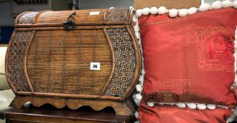 RATTAN AND SEAGRASS BOMBE SHAPED CASKET AND TWO ELEPHANT POMPOM CUSHIONS