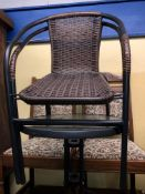 SMALL CIRCULAR GLASS TOP PATIO TABLE AND TWO STACKING RATTAN CHAIRS