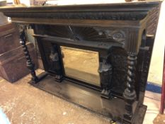 VICTORIAN CARVED OVERMANTEL MIRROR WITH MOULDED PEDIMENT THE CENTRAL MIRROR FLANKED BY MEDIEVAL